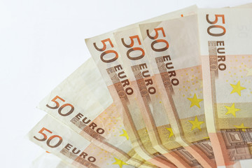 50 euro banknotes on white wooden background