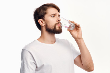 man drinking water in a white t-shirt healthy lifestyle