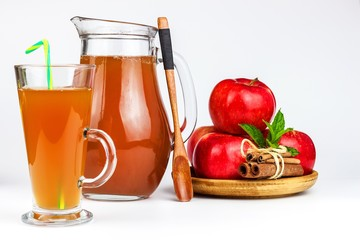 Fresh apple juice in a glass. Fruit harvest. Healthy beverage. Apples on the kitchen table. Production of juice. On a white background.