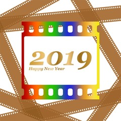 New year greetings for 2019 with colorful blank film and photographic window with golden inscription Happy new year and number 2019 on a background of brown film strips