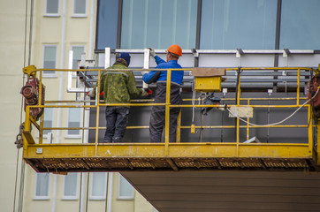 construction worker on a scaffold, symbol photo for building, construction boom, labor protection