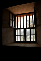 Light comes through panes of an old window