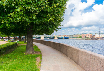 The Spit of Vasilyevsky Island and the view of the Birzhevoy Bridge in the summer in St. Petersburg. Russia