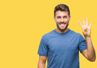 Fototapeta Young handsome man over isolated background showing and pointing up with fingers number four while smiling confident and happy. obraz