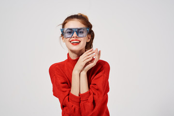 happy woman in glasses and red sweater