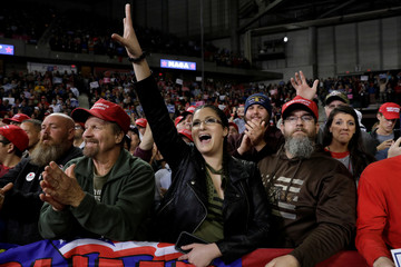 Supporters of U.S. President Trump cheer as he speaks at a campaign rally in Topeka, Kansas
