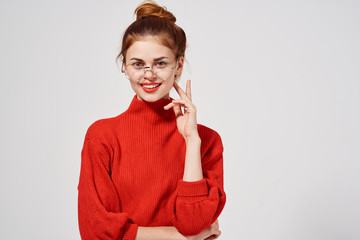 woman in a sweater and glasses