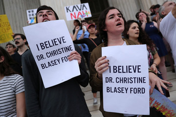 Protesters demonstrate on the steps of the U.S. Supreme Court building against the swearing in of Supreme Court Justice Brett Kavanaugh in Washington