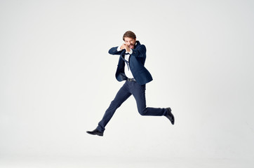 a man in a suit jumps high