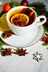 Hot tea  with spices on a wooden background. Selective focus.Still life, food and drink, seasonal and holidays concept.