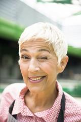 Portrait of an senior  woman who hints
