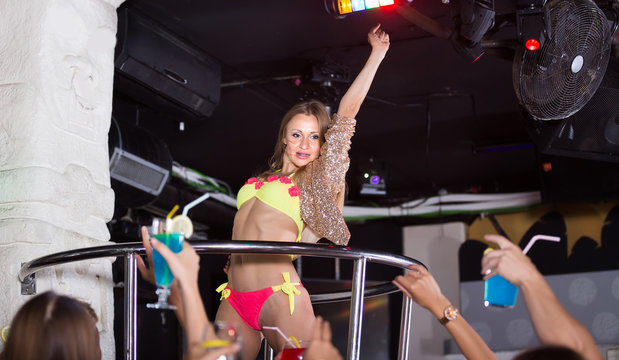 woman dancer gogo dancing in the night club on stage