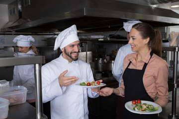 Staff of restaurant with head chef working