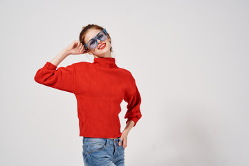 woman in blue glasses in a red sweater