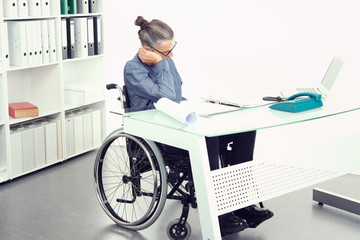 disabled business man in wheelchair is sorrowful