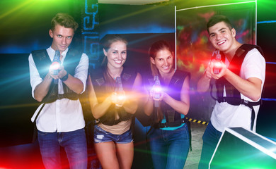 Young people posing with laser pistols