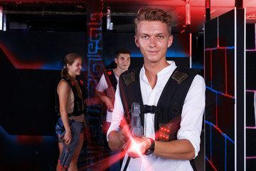 guy holding laser pistol playing laser tag game