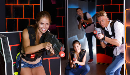 young people playing laser tag