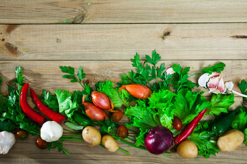 Vegetables assortment on wooden background, vegan cooking concept