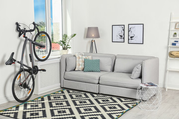 Modern living room interior with bicycle near wall