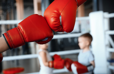 Little kid with trainer in boxing gloves on ring Wall mural