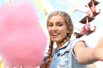 Printed kitchen splashbacks Amusement Park Attractive woman taking selfie with cotton candy in amusement park
