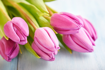 Pink Tulips. Flower background. Wooden background. Close up.