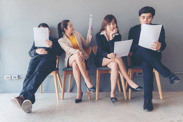 Group young and adult of asian people waiting for job interview recruitment.  Applicants waiting for a job interview.  Recruitment Concept.