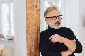 Mature man with glasses wearing polo neck jumper