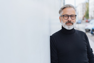 Mature bearded man with polo neck jumper