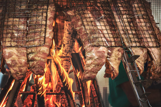 asado, traditional way of preparing food (usually consists of beef, sausages, and sometimes other meats, which are cooked on a grill)