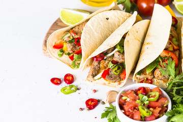 Mexican pork tacos with vegetables and salsa. Wall mural
