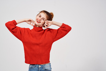 beautiful woman in a sweater on a gray background