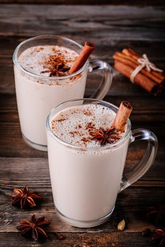 Homemade Chai Tea Latte with anise and cinnamon stick in glass mugs