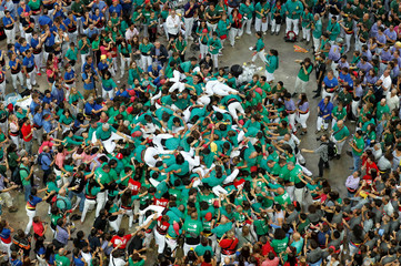 """Members of group """"Castellers de Sabadell"""" form a human tower called """"castell"""" during a biannual human tower competition in Tarragona"""