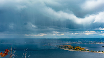 clouds and rain over the river