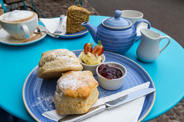 english cream tea with scones, clotted cream, marmelade and tea