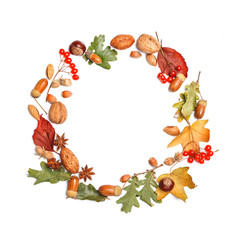 Round frame, autumn composition. Dry leaves, nuts and spices on a white background. Isolated. Top view. Copy space