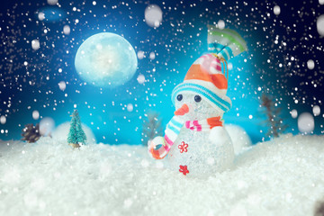 Christmas snowman with Xmas lights and snow on moonlights. The elements of this image furnished by NASA