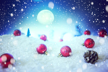 Christmas card with a winter forest and christmas decorations in a moonlit night. The elements of this image furnished by NASA