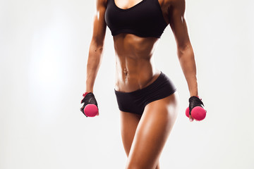 Perfect Fitness Body of Beautiful Woman. Fitness Instructor in Sports Clothing. Female Model with Fit Muscular and Slim Body in Sportswear doing Workout. Young Fit Girl Lifting Dumbbells.