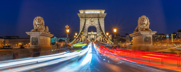 Wall Mural - Panorama of Chain bridge at night with car light trails  in Budapest, Hungary