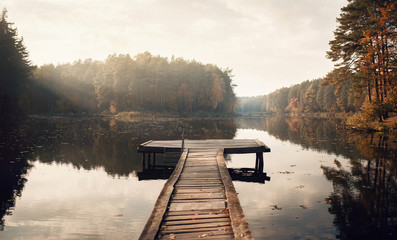 Autocollant pour porte Gris The Breath Of Autumn. Autumn foliage and fog lake in morning with boat dock