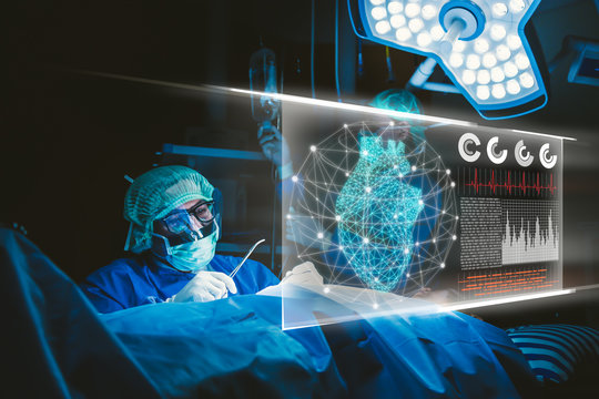 Doctor with virtual reality in operation room in hospital.Surgeon analyzing patient heart testing result and human anatomy on technological digital futuristic virtual interface,digital holographic