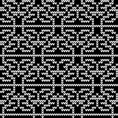 Geometric, national pattern. Vector abstract seamless background with elements of a knitted pattern of whiteornaments on a black background. For design, decoration, packaging, fabric