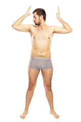 Man without clothes, in shorts, isolated on white background
