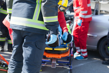 Paramedics and firefighters in a rescue operation after a car crash