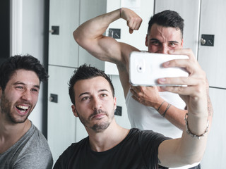 happy friends at the gym after exercising