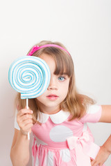 portrait of a Cheerful young girl with a lollipop