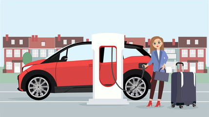 Woman traveler with baggage charges an electric car at a charging station